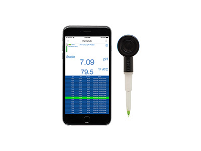 Hanna Instrument's HALO wireless pH meter on the side of an iphone.
