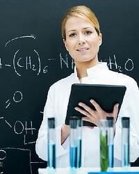 Woman in classroom with beakers