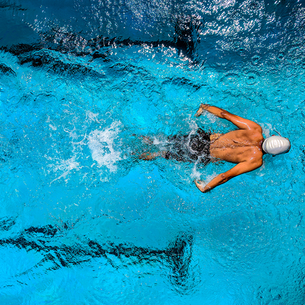 Swimmer in pool with swimcap